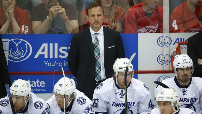Tampa Bay Lightning head coach Jon Cooper watches against the Detroit Red Wings in the third period of Detroit's Game 3 victory in a first-round Stanley Cup playoff series in Detroit. Cooper once coached in Lansing.