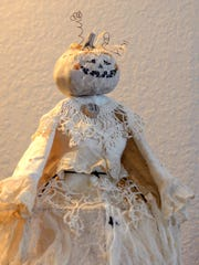 A handmade goblin or pumpkin bride decoration was created by Martha Kohley using gowns made out of cheesecloth, lace, buttons and dollies. They were Kohley's favorite to make this year.
