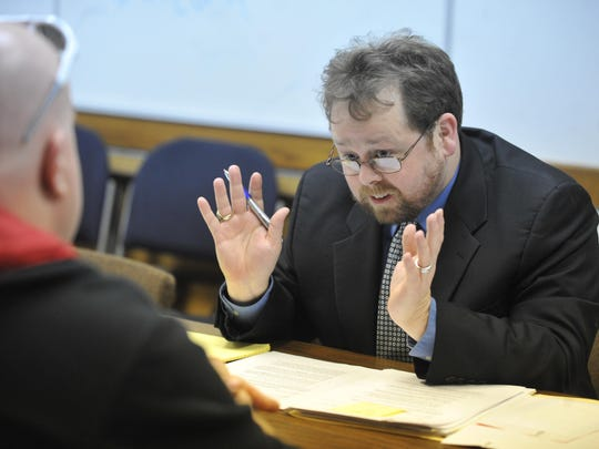 Whitewater Valley Pro Bono Commission director Shane Edington, right, talks with a client.