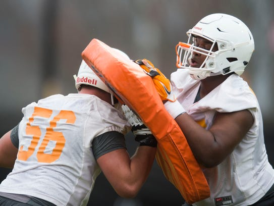 From left Tennessee's Riley Locklear (56) and Jerome