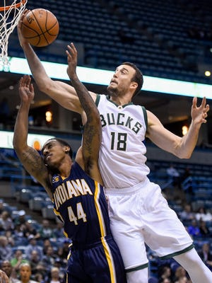 Bucks center Miles Plumlee and Pacers guard Jeff Teague battle for a rebound Wednesday.