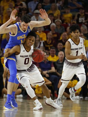 ASU's Tra Holder (0) draws a foul on UCLA's Gyorgy Goloman (14) during first half at Wells Fargo Arena on February 10, 2018 in Tempe, Ariz.
