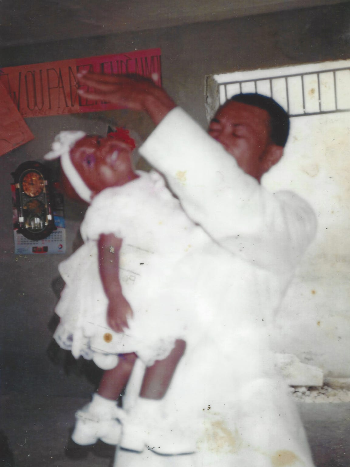 Chika is baptized in 2010 as Haiti is recovering from