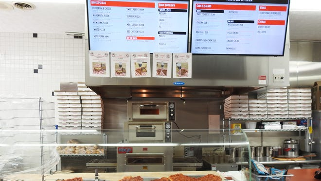 Pizza is available by the slice at the new Maxwell's Pizza Express in the Marathon building on East Pike.