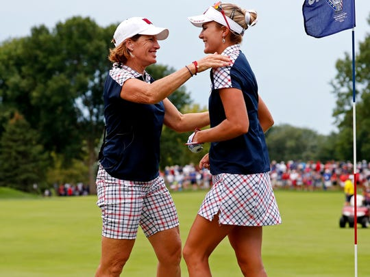 Lexi Thompson, right, gets a hug from U.S. captain Juli Inkster after her completing her final round.
