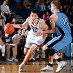 East Lansing freshman Brandon Johns, left, has been selected to the 2015-16 USA Basketball Junior National Team.