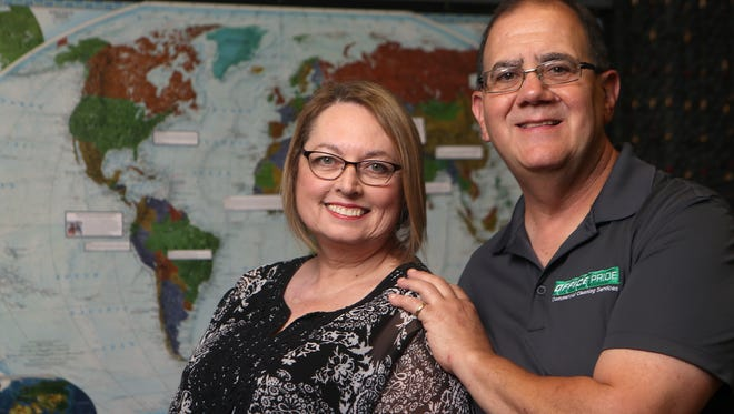 Lori Carlino and her husband Steve pose for a photo on Friday, Aug. 11, 2017, at Fellowship of Oso Creek in Corpus Christi. The pair volunteer as respite care providers for foster children and their foster parents.