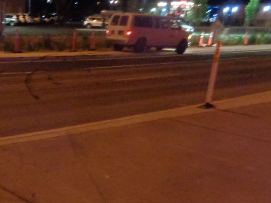 A white van, upper right corner, sits Thursday, July 12, 2018 on a Reno street in Reno after driving the wrong way on Interstate 80, according to the Nevada Highway Patrol.