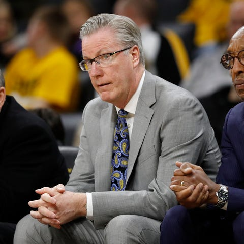 Iowa head coach Fran McCaffery, center, cannot...
