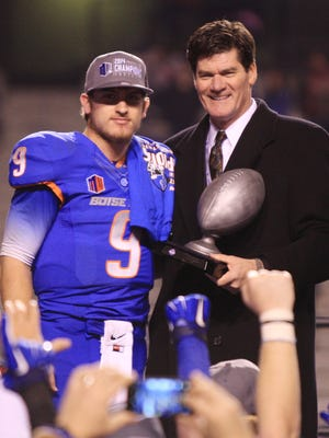 Boise State Broncos quarterback Grant Hedrick (9) accepts the offensive player of the game from Mountain West commissioner Craig Thompson during the celebration after Boise State on the Mountain West Football Championship 28-14 over the Fresno State Bulldogs on Dec. 6 at Albertsons Stadium.