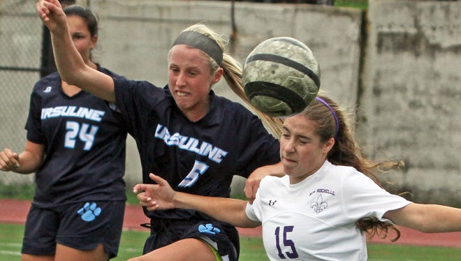 Ursuline's Lily Flynn battles New Rochelle's Sophie Wolf during a varsity soccer match at New Rochelle High School Sept. 30, 3015.
