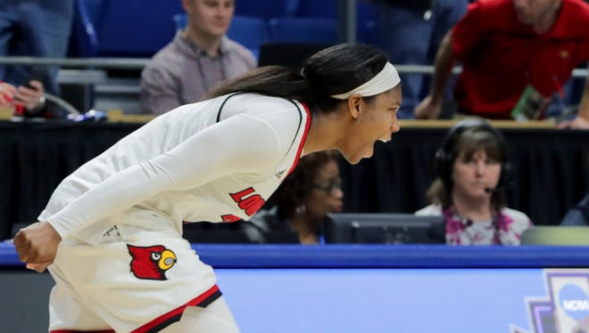 Louisville's Myisha Hines-Allen celebrates after the Cards defeat Stanford 86-59 in the NCAA Sweet Sixteen.