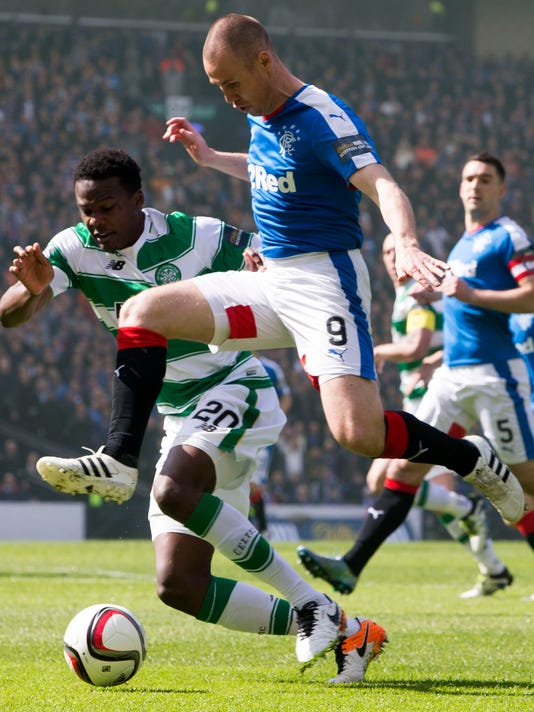Celtic's Dedryck Boyata, left, and Rangers' Kenny Miller, in action during the Scottish Cup semi-final soccer match at Hampden Park, Glasgow, Sunday April 17, 2016. (Jeff Holmes / PA via AP) UNITED KINGDOM OUT - NO SALES - NO ARCHIVES