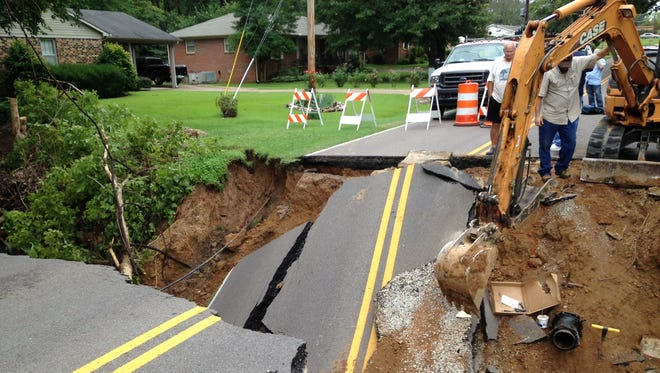 Heavy rain contributed to a section of road on East University Parkway collapsing Monday.