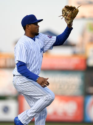 Iowa Cubs Third Baseman Jeimer Candelario (35) makes a catch on Tuesday, April 11, 2017, during the home opener baseball game between the Iowa Cubs and the New Orleans Baby Cakes at Principal Park.