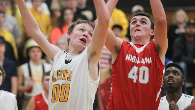 Highland's Chris Mellinger pulls up for a shot during the Huskies' game in Lone Tree on Tuesday, Dec. 15, 2015.