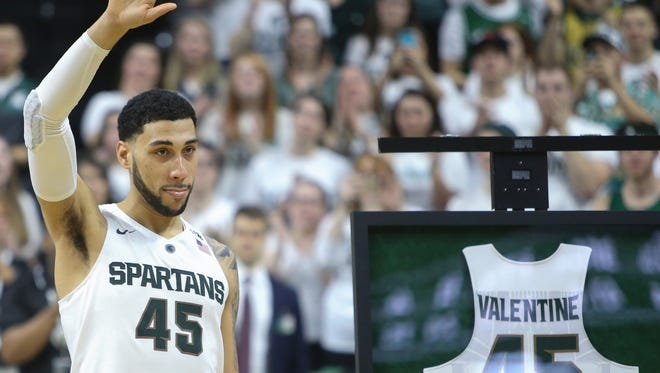 Michigan State guard Denzel Valentine waves to fans during senior day on Saturday, March 5, 2016, at the Breslin Center in East Lansing.