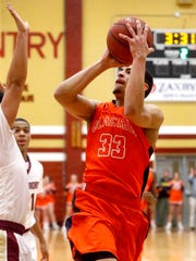 Blackman's Trent Gibson (33) goes up for a shot as Riverdale's Shaun Morrow (0) defends Friday.