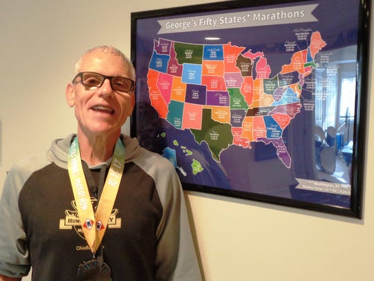 George Brennock proudly displays the ribbon and medal