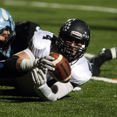 Chatham's Ryan Barnett into the end zone for a first half touchdown vs defending sectional champion Parsippany Hills in a showdown with playoff implications. October 30, 2015, Parsippany, NJ.