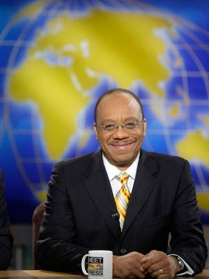 """WASHINGTON - NOVEMBER 23:  (AFP OUT) Washington Post columnist Eugene Robinson smiles during a taping of """"Meet the Press"""" at the NBC studios November 23, 2008 in Washington, DC. Robinson spoke on various topics including the auto industry's plea for financial help from the congress.  (Photo by Alex Wong/Getty Images for Meet the Press)"""