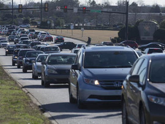 Holiday shopping traffic builds up on Woodruff Road.