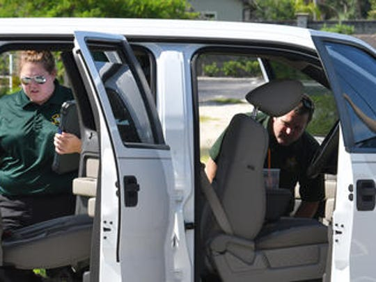 Deputies search through a pick up possibly struck by