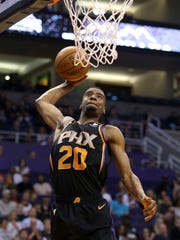 Josh Jackson rises up for a dunk during a game against the Hawks on Feb. 2 at Talking Stick Resort Arena.