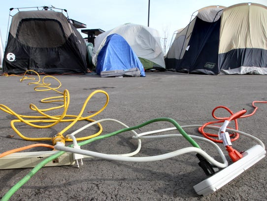 Power lines trail off to some of the 26 tents at the