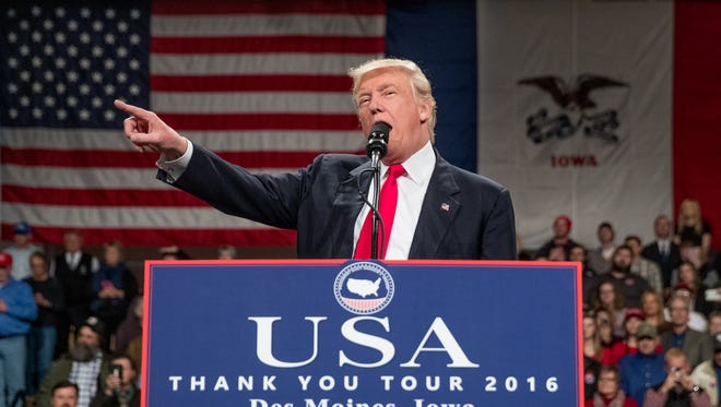 President-elect Donald Trump speaks at a rally at Hy-Vee Hall on Thursday in Des Moines, Iowa.