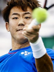 Yoshihito Nishioka hits a return shot against John Isner during their second round match at the Memphis Open.