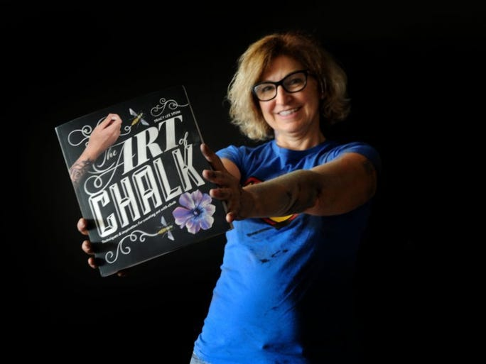 JUAN CARLO/THE STAR Tracy Lee Stum of Ventura and her new first book, 'The Art of Chalk,' is scheduled for release this month. Stum will be at the I Madonnari festival on Saturday to Monday at Mission Santa Barbara.