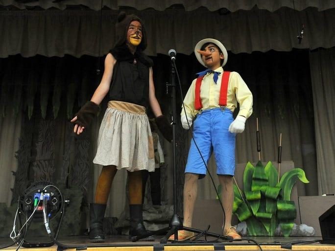 ROB VARELA/THE STAR Ventura Charter School of Arts & Global Education fifth-graders Mary Ward-Zaragoza, as Mama Bear, and River Nieto, as Pinocchio, rehearse 'Shrek' in Wednesday.