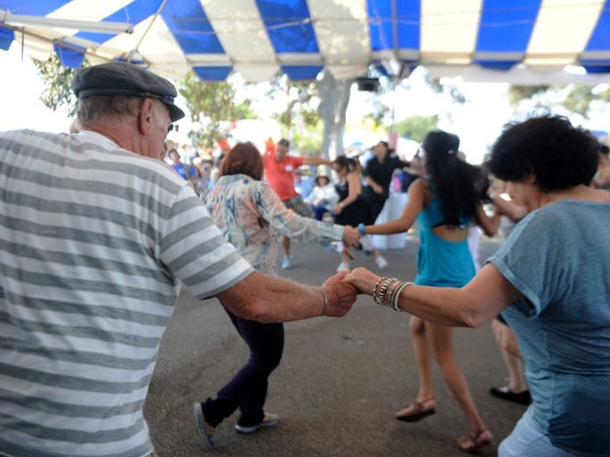JUAN CARLO/THE STAR Dancing was among the fun Saturday during the 38th annual Ventura County Greek Festival at the Camarillo Airport.