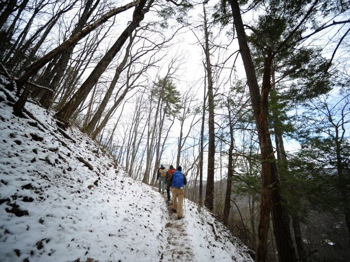 Emily Baird, Kristine Johnson, and Morgan Simmons hike the beginning of Chestnut Top Trail in the west end of Great Smoky Mountains National Park, near Townsend, on Feb. 11, 2016.