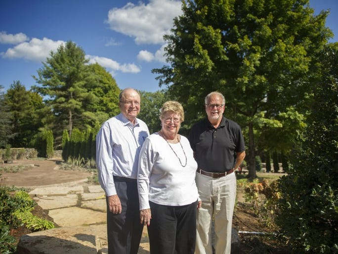 Rich and Jane Ray pose for a photo with Knoxville Botanical Garden & Arboretum Executive Director Jim Richards, in front of the new Secret Garden at the Knoxville Botanical Gardens & Arboretum in East Knoxville on Tuesday Sept. 20, 2016. The garden is modeled after Frances Hodgson Burnett's children's story, and funded by the Rays in memory of their late daughter Andie.