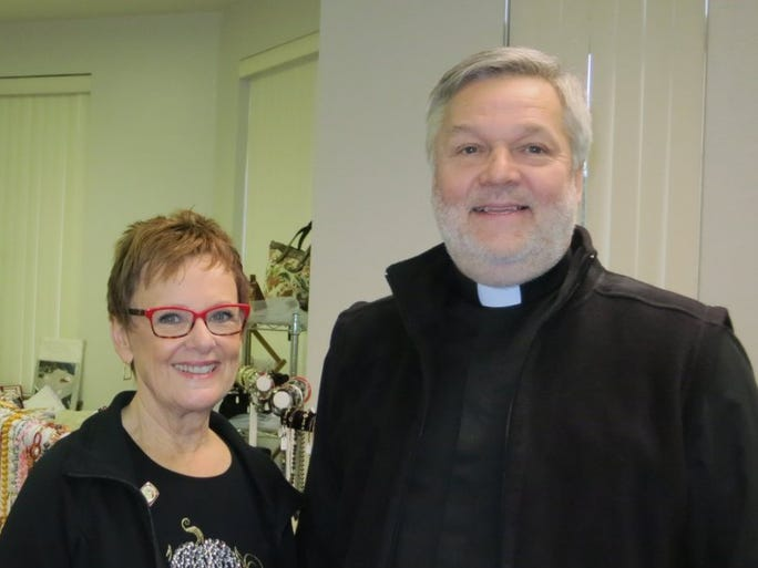 Jacque Jabs/Special to the Record Searchlight Jan Logue of Redding and the Rev. Paul Bland of Shasta Lake attend the Harvest Bazaar on Saturday at All Saints Episcopal Church in Redding.
