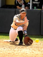 Abilene High first baseman Sydnee Killam (4) digs out