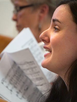 Jamie Reynolds rehearses Tuesday evening at the First Congregational Church.