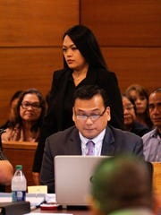 """Witness Abigail Reyes walks past defense attorney Joaquin """"Jay"""" Arriola as she approaches the stand during the Mark Torre Jr. murder trial at the Superior Court of Guam on Feb. 15, 2017. Reyes testified that she was in a physical relationship with Elbert Piolo for several years."""