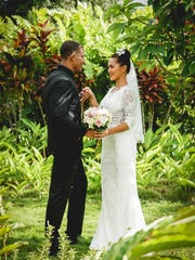 Fred Feaster and Muneka Taisipic model bridal fashions