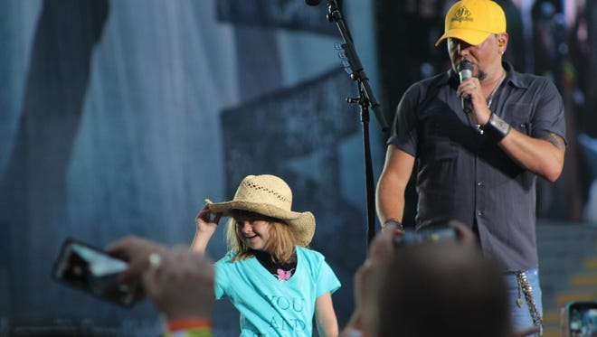 """Nine-year-old Brooke Marshall enjoys her time onstage with Jason Aldean for """"She's Country"""" at Lambeau Field. She lives in Georgia, but her parents are natives of the Green Bay area."""