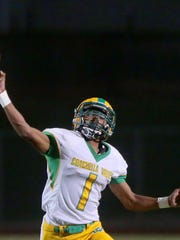 Coachella Valley quarterback Armando Deniz throws against