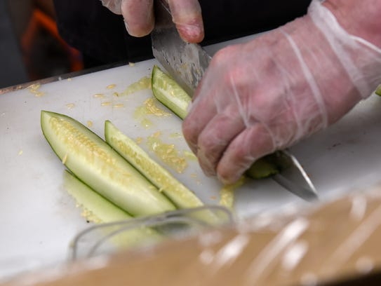 Chef Matt Annand prepares ingredients  during a class