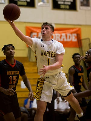Naples' Jack Youmans (1) lays the ball in against Deerfield Beach during a first round game of the Gulfshore Holiday Hoopfest at Golden Gate High School Wednesday, Dec. 27, 2017 in Golden Gate Estates.