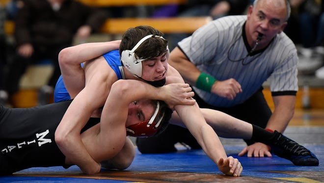 Foley's Noah Lefebvre tries to pin Milaca's Roy Marx but settles for a win in the 152-pound match Friday at Foley High School.