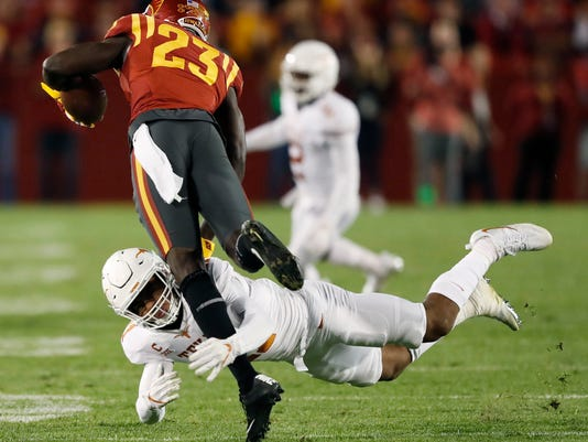 Iowa State wide receiver Matthew Eaton (23) is tackled by Texas defensive back P.J. Locke III after making a reception during the first half of an NCAA college football game, Thursday, Sept. 28, 2017, in Ames, Iowa. (AP Photo/Charlie Neibergall)