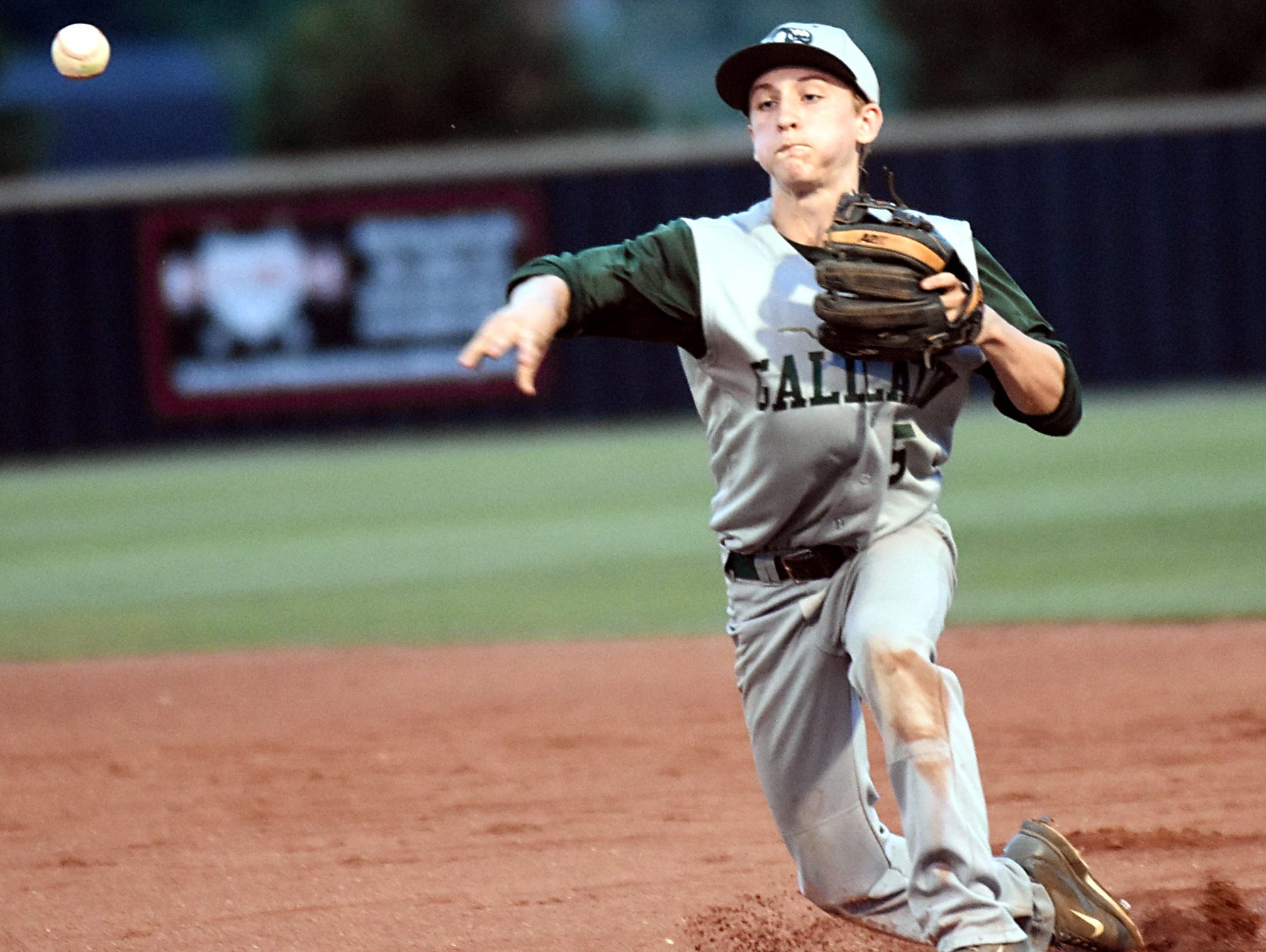 Gallatin High junior second baseman Nathan Kernell throws to first base for a third-inning putout.