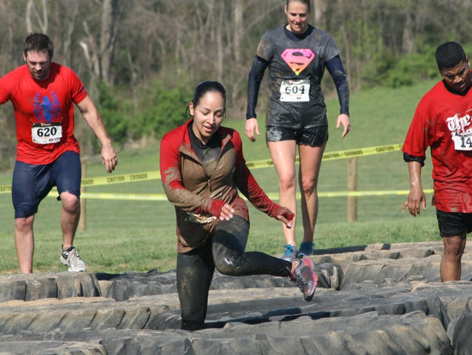 Runners endured a several mile, obstacle-filled course at the inaugural Hero Run on Saturday at Honeysuckle Hill Farm near Coopertown. Ticket sales from the event benefitted Monroe Carell Jr. Children's Hospital at Vanderbilt.
