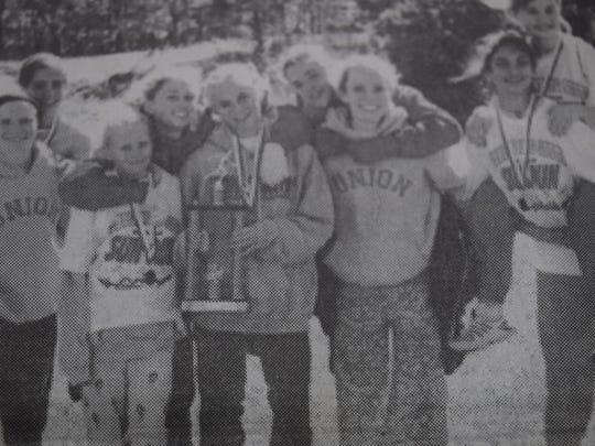 The Bravettes cross-country team in October 2004 was Caroline Johnson, Maddie White, Alyssa Huff, Amanda Huff, Olivia Gatten, Meagan McBride, Amanda Johnson, Annie Adelman, and Brooklyn Kirchner.